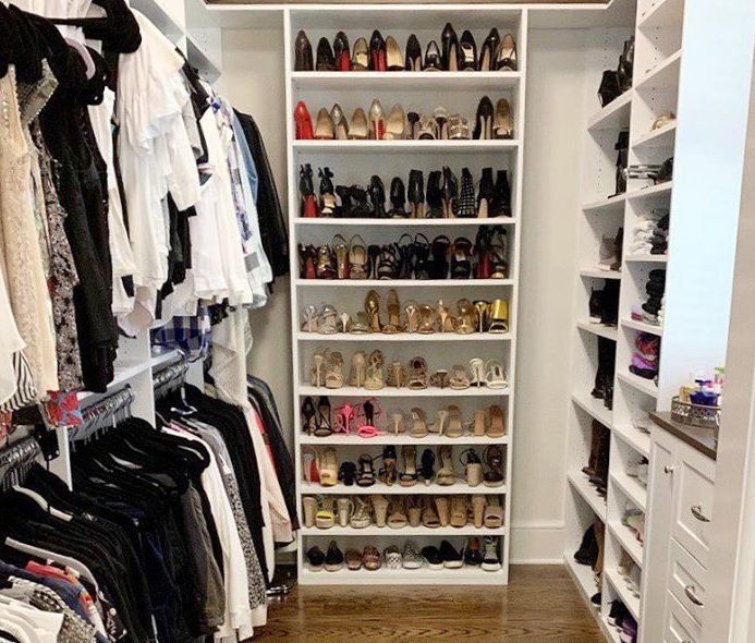 A Saint Louis Closet Co. closet with high shelves organized by Lizzy Kline.