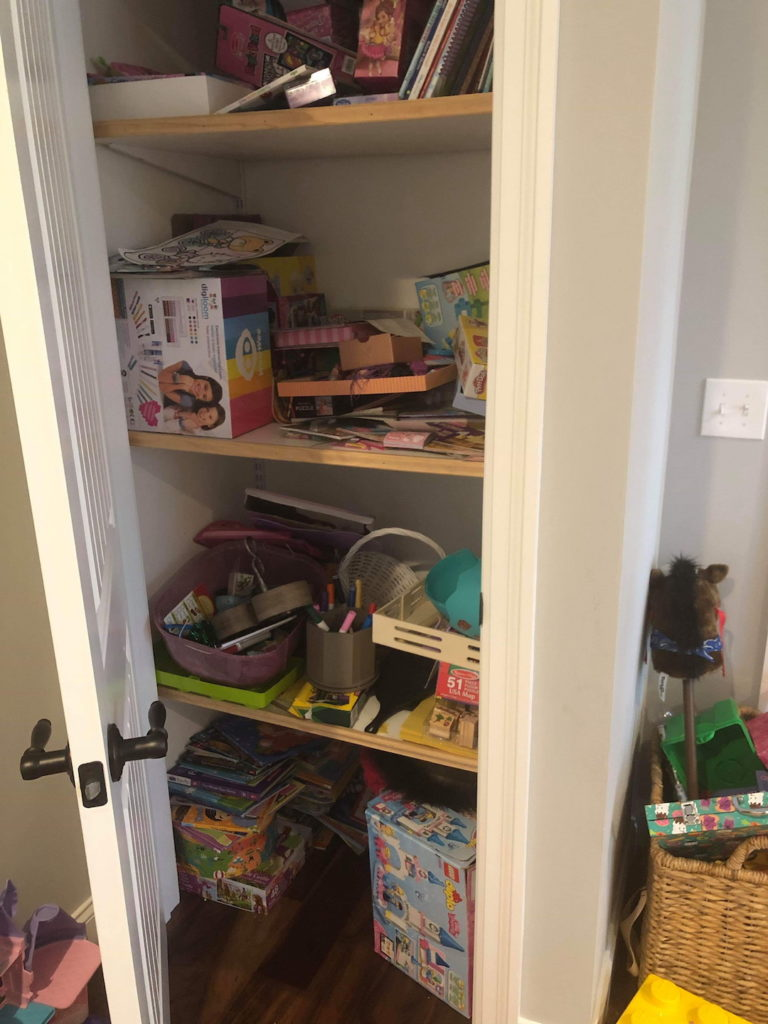 Organized Playroom closet - before